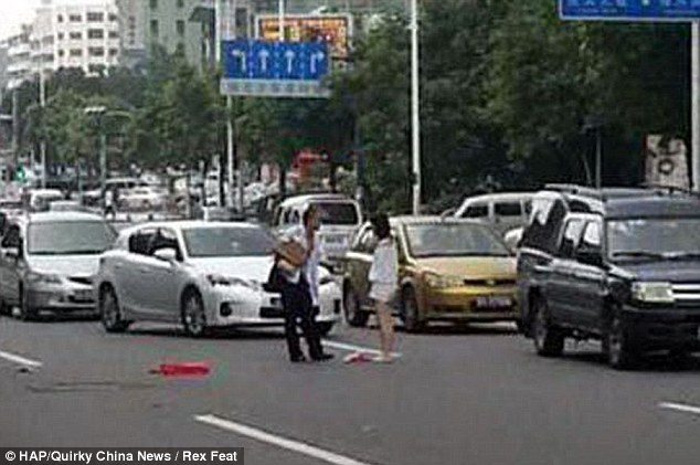 Row that was just too hot to handle: The couple were seen arguing in the middle of the street in Dongguan, Guangdong Province, China