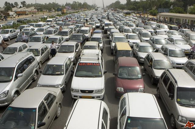 Rush hour traffic approaching Gurgaon at the toll tax collection barrier stands clogged due to a local protest by Kuldeep Bishno