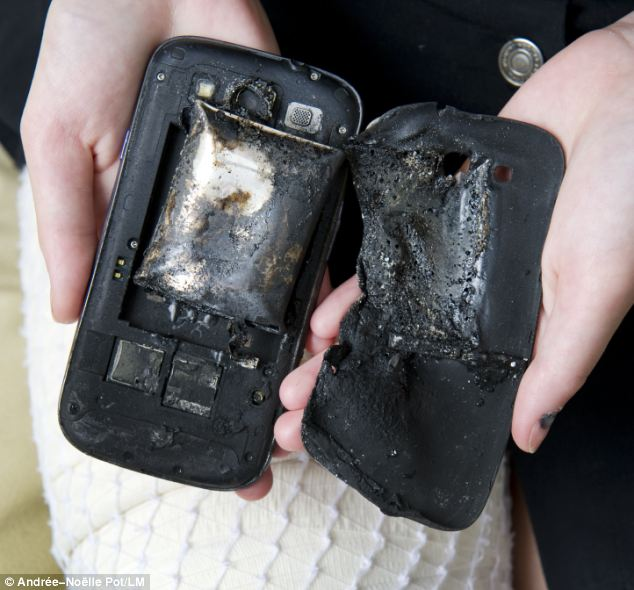 The fire damage to the Samsung S3 phone, pictured, is thought to have been caused when the battery exploded. Samsung said it will launch a 'thorough examination to determine the exact cause'