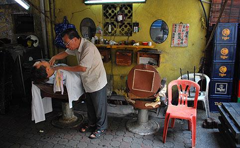 Petaling Street barber Off Jalan Sultan, opposite Chatime.