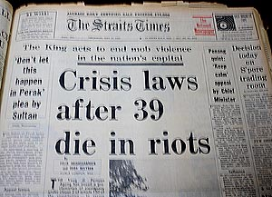 newspaper headlines ''Crisis laws after 39 die in riots' from the Strait Times'