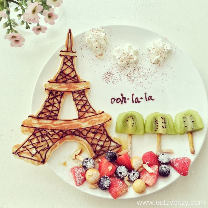 J'adore Paris.   With Love, Leesamantha - created June 2013 Instagram @leesamantha  Ingredients: 1. Eiffel Tower made of pancakes.  - Pancake batter in the squeeze bottle to draw the shape. - Nutella or Choc fudge for details.   2. Clouds - Whipped cream    3. Trees - Kiwi - Veggie sticks  4. Landscape - Fruits