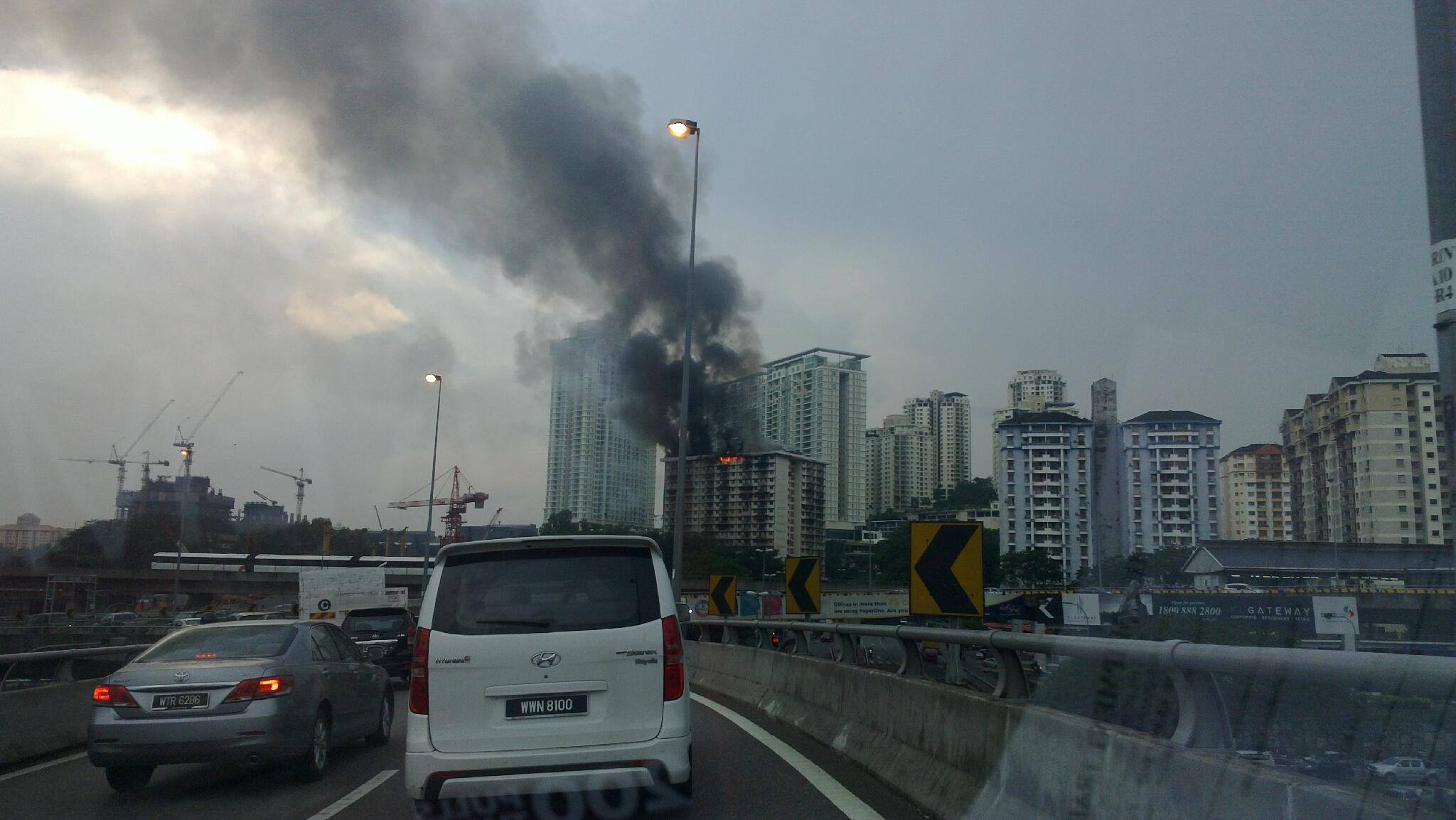 Photo of a burning apartment spotted on from the highway.