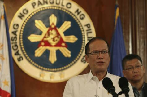 Philippine President Benigno Aquino III, left, talks about updates on powerful Typhoon Haiyan on national television at the Malacanang palace in Manila, Philippines on Thursday Nov. 7, 2013.