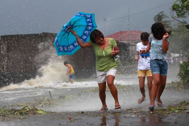 Strong winds from the typhoon hit a coastal town in Laguna Province. More than 700,000 evacuated ahead of the storm.