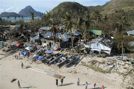 An aerial view shows damaged houses, as residents wave for help after Typhoon Haiyan hit a village in Panay island, in northern Iloilo Province, central Philippines November 9, 2013.