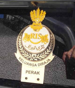 A photo of royalty car crest in Malaysia.