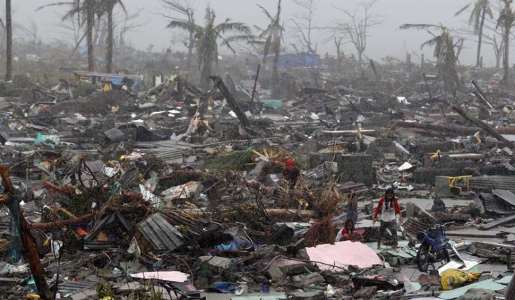 The United Nations estimates 10,000 people may have died in Tacloban alone, where five-metre (16-foot) waves flattened nearly everything in their path as they swept hundreds of metres across the low-lying land. (AP)