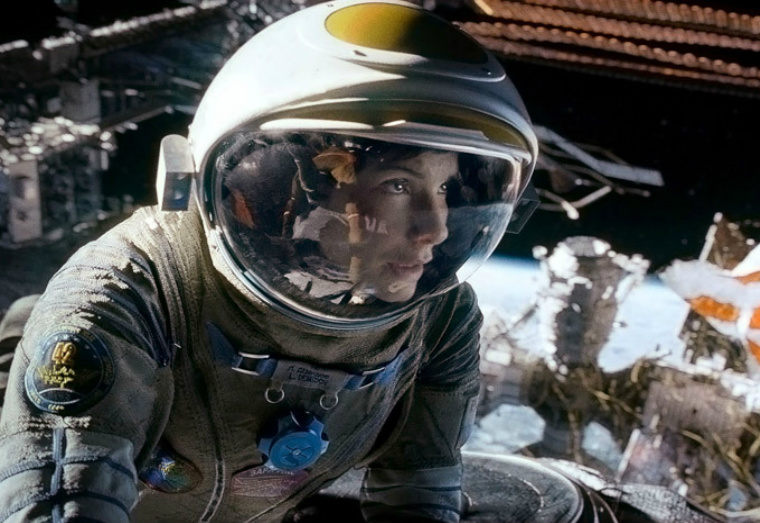 "Movie still of ""Gravity"" starring Sandra Bullock and George Clooney."