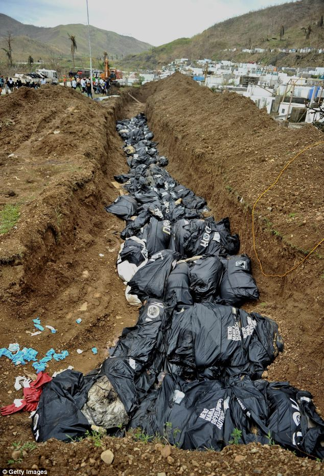 Almost 400 bodies lie in a hastily-constructed mass grave.