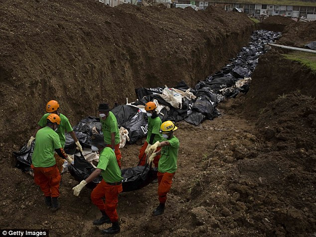 Hundreds of bodies lay rotting in a hastily-constructed trench.