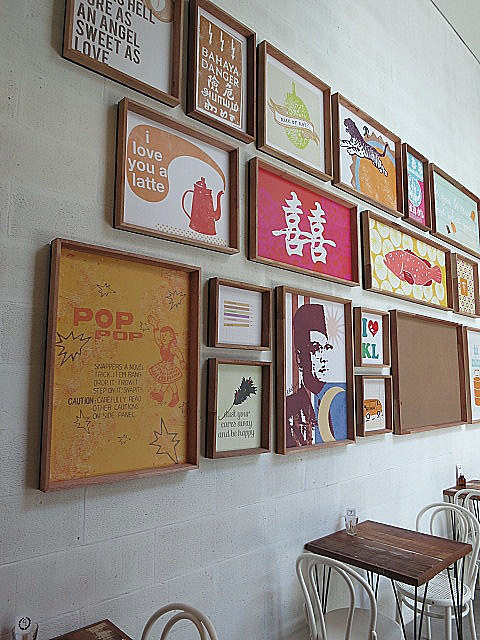 Malaysia-flavoured artwork on the cafe's walls. Photo from Eatdrinkkl.