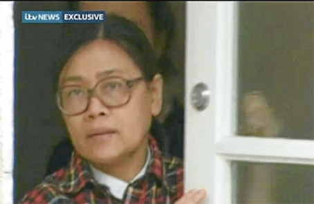 A screenshot of Siti Aishah from a documentary on the Maoist sect.