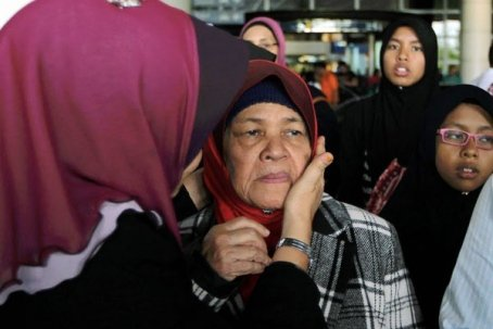 Kamar Mahtum greeted by relatives after landing in KLIA.