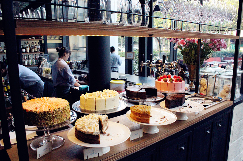 Yummy cakes prettily decorated on display in Acme Bar & Coffee. Photo from Little Penguin Princess.