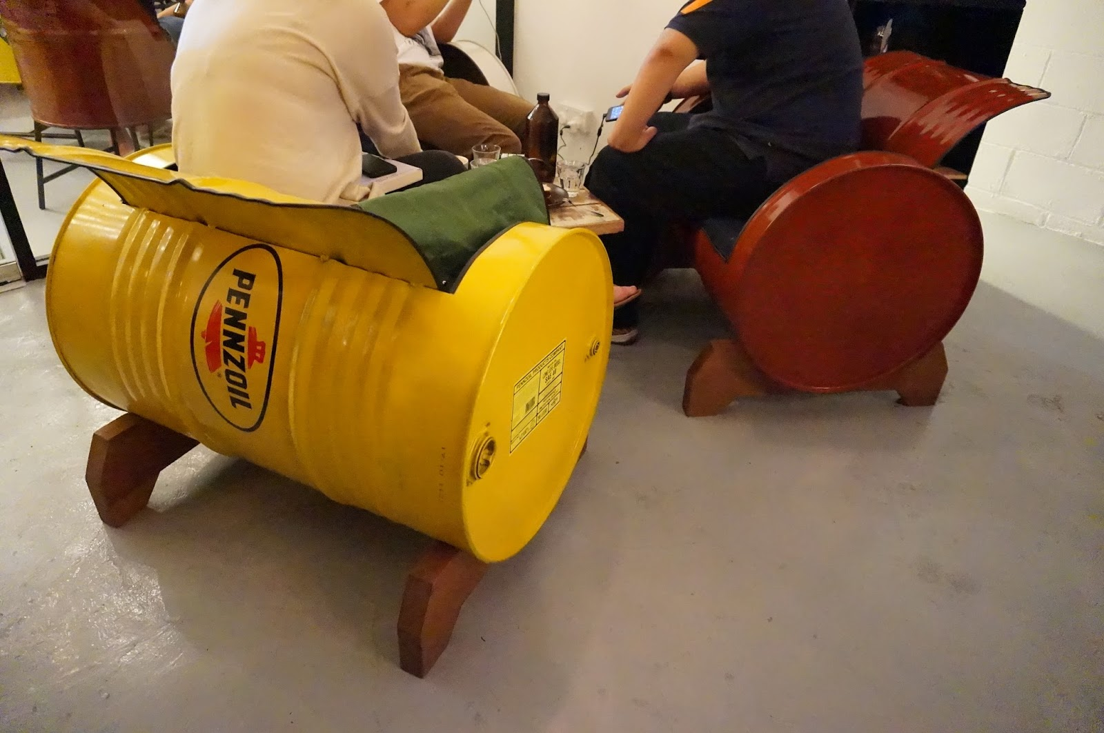 Nice chairs made from oil containers.