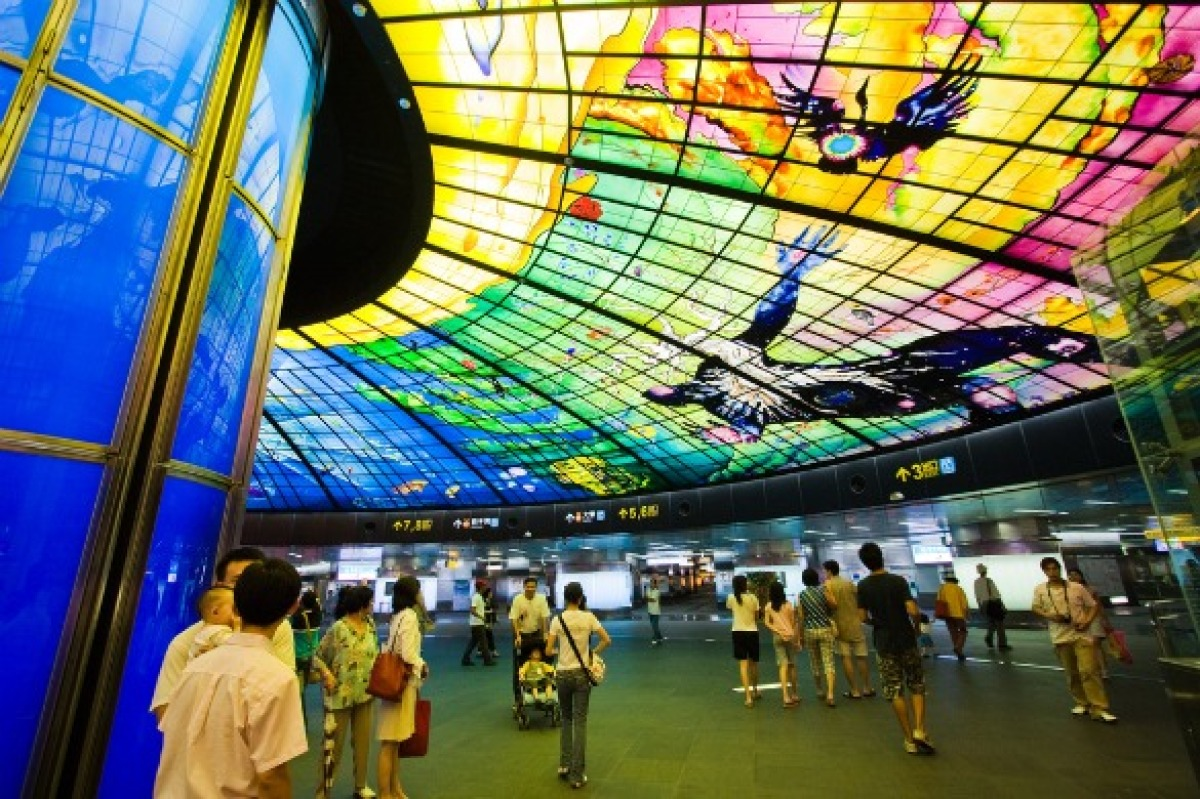 """Formosa Boulevard is a transfer station for the Red and Orange Line in Kaohsiung City. The station is famous for the """"Dome of Light,"""" the world's largest public art installation that comprises individual pieces of colored glass."""