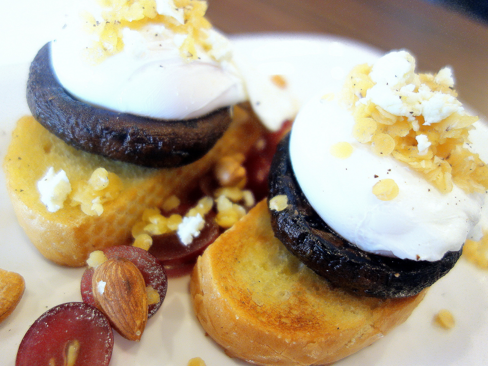 Poached eggs with slow-baked portobello mushrooms, nuts, grapes & lentils, served on toast. Photo from Eatdrinkkl.