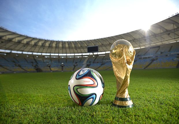 Trophy shot |  The Brazuca sits next to the World Cup trophy