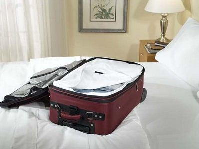 If you're travelling alone, put your belongings on both beds