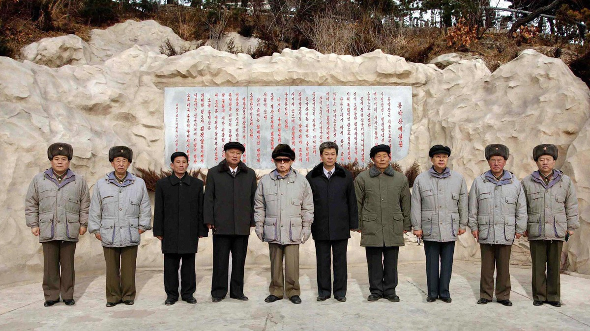 This undated picture, released by Korean Central News Agency on Jan. 18, 2009 shows North Korean leader Kim Jong Il (center) posing with Jang Song Thaek (third from right), department director of the Workers' Party of Korea Central Committee and other members.