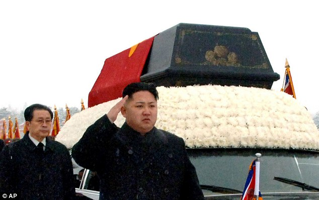 Kim Jong Un (front centre) is followed by Jang Song Thaek (left) in December 2011 as he salutes beside the hearse carrying the body of his late father Kim Jong Il during a funeral procession in Pyongyang