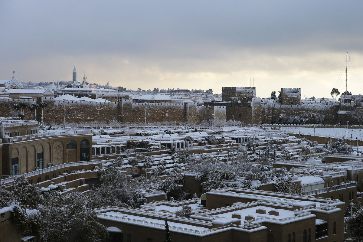 Snow covers the city during a snowstorm in Jerusalem Friday, Dec. 13, 2013.