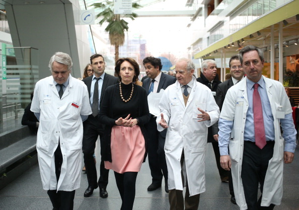 French leading heart transplant specialist Alain Carpentier (2ndR), professor Jean-Noel Fabiani (L), head of the department of cardiovascular surgery and transplantation of organs at Georges Pompidou European hospital in Paris and professor Christian Latremouille (R), member of the service, arrive with French Social Affairs and Health Minister Marisol Touraine (3rdR) for a press conference in Paris on December 21, 2013, after the team made the first human trial of an artificial heart on December 18