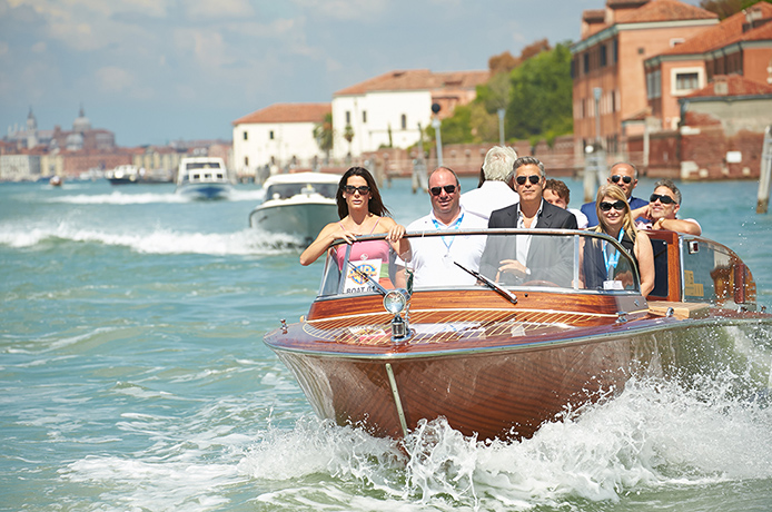 Sandra Bullock and George Clooney arrive in style. Photo from Rex Features.