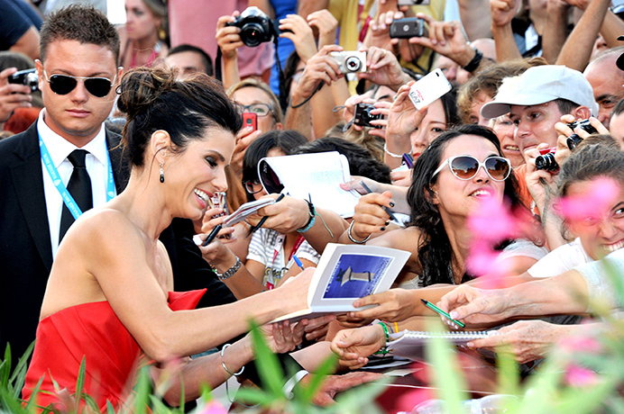 Sandra Bullock signs autographs at the Gravity film premiere. Photo from Rex Features.