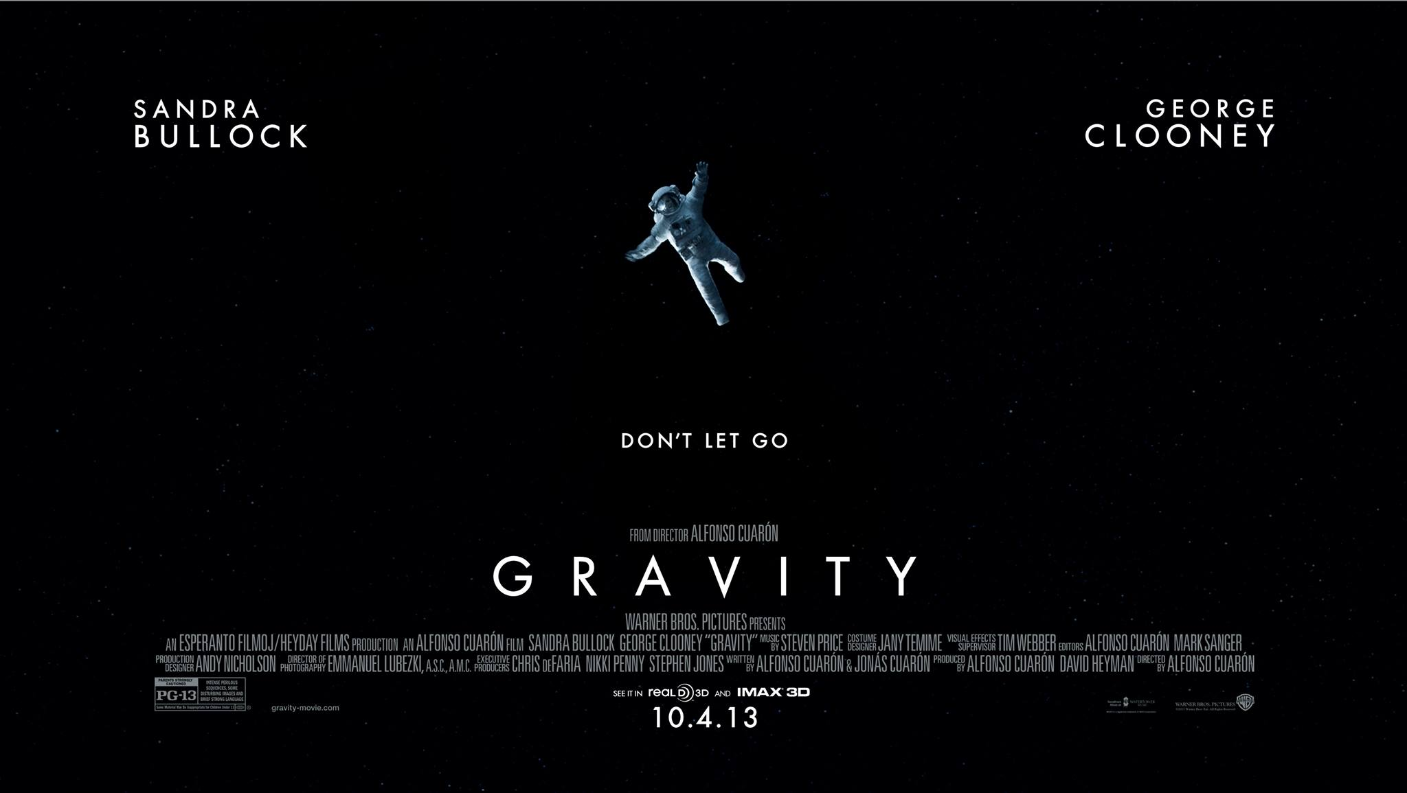 "Movie poster of ""Gravity"" starring Sandra Bullock and George Clooney."