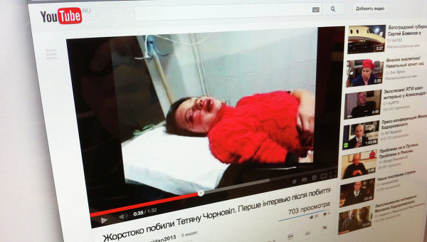 A snapshot from the video showing the beaten journalist Tatyana Chornovol