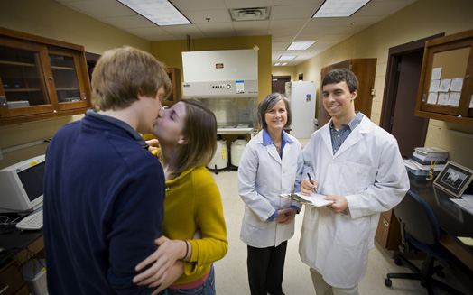 Two Lafayette College undergraduates kiss for research by neuroscience professor Wendy Hill (second from right) and her student research assistant, Evan Lebovitz (right).