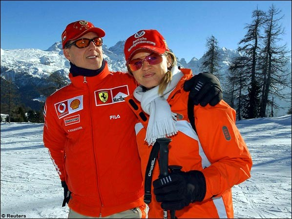 German driver Michael Schumacher and his wife Corinna pose in Madonna di Campiglio, Italy, in 2003. Schumacher is in this Dolomites mountain resort for the annual Ferrari meeting with the media.