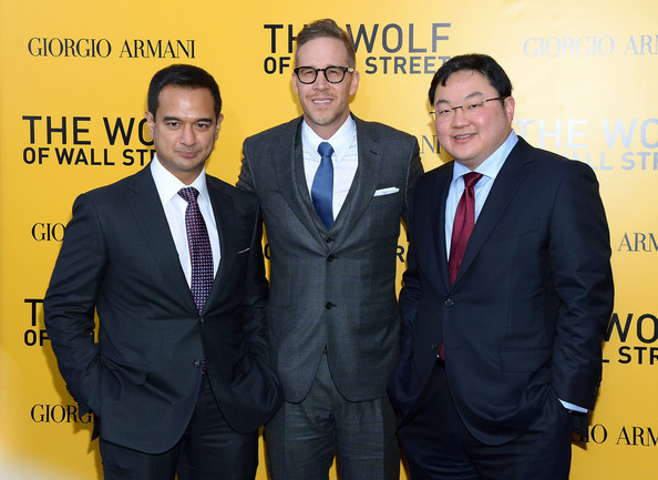 Red Granite Picture's Riza Aziz and Joey Mcfarland with finance 'whiz kid' Jho Low at the launch of Wolf Of Wall Street.