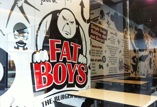The interior of Fatboy's Burger Bar in Publika features black and white deco.