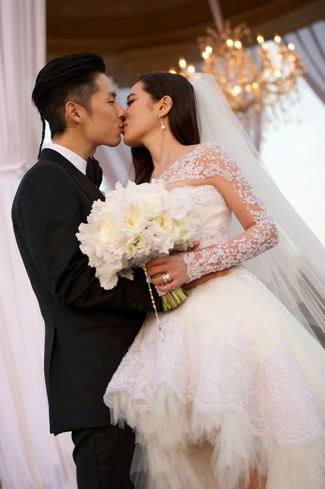 Vanness Wu kisses his bride in their Los Angeles wedding ceremony.