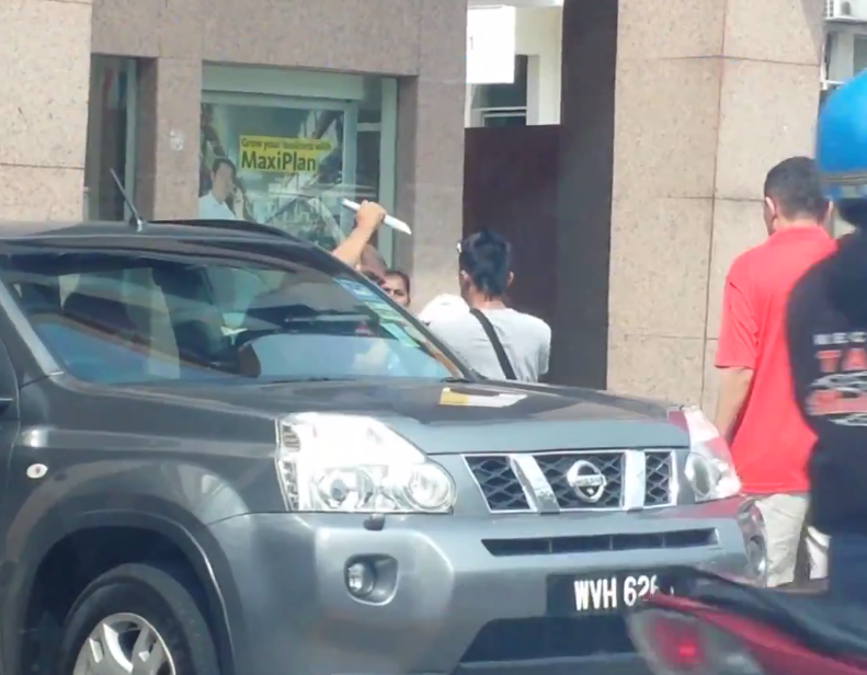"Screen grab from video titled ""Foiled Snatch Thief At Maybank Damansara Uptown Jan 2014""."