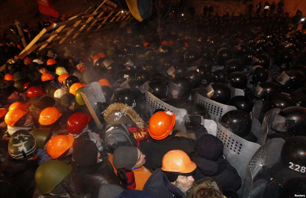 Dozens of protesters were wounded in a clash with police in Kiev on November 30.