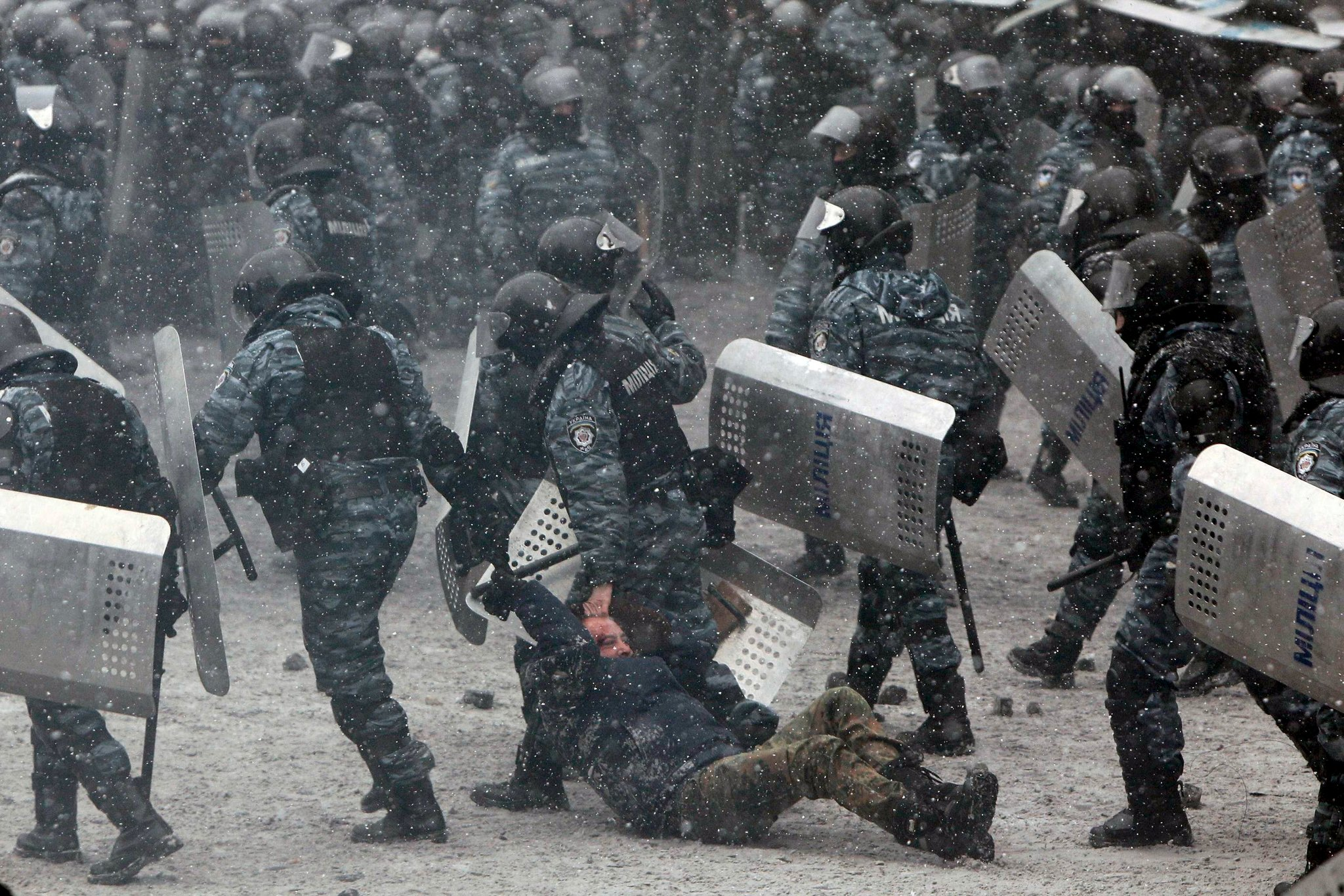 Police detained a man in Kiev during clashes with protesters.