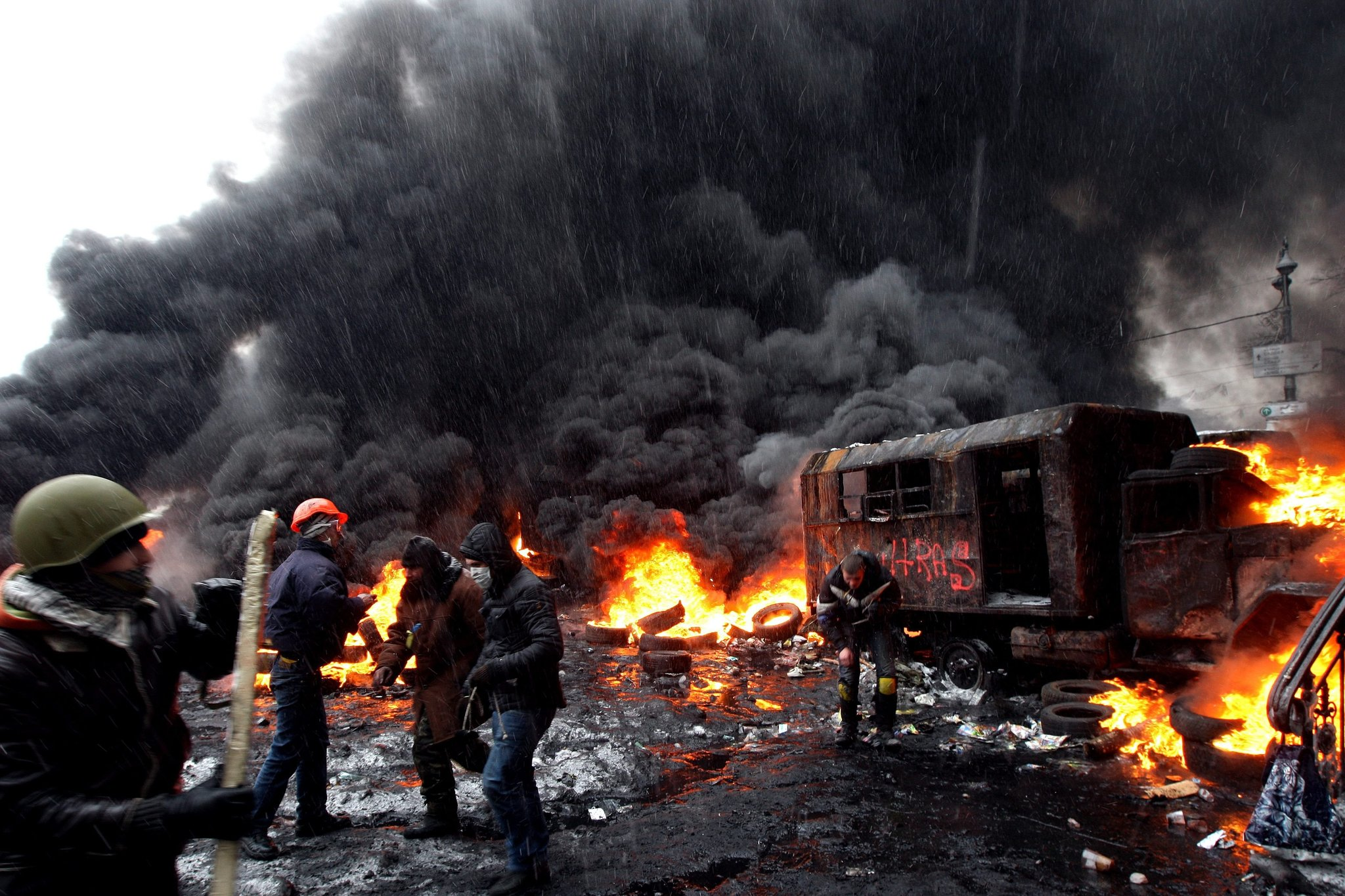 Protesters have turned charred police buses into barricades.