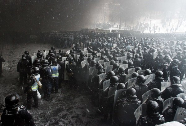 Riot police officers gathered as they clashed with protesters on Wednesday in the center of Kiev, Ukraine