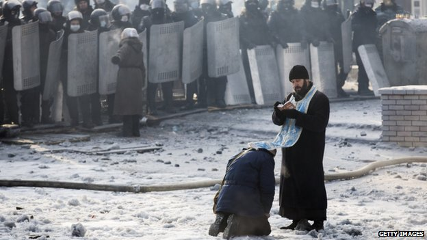 Orthodox priests have been urging security forces to refrain from using violence