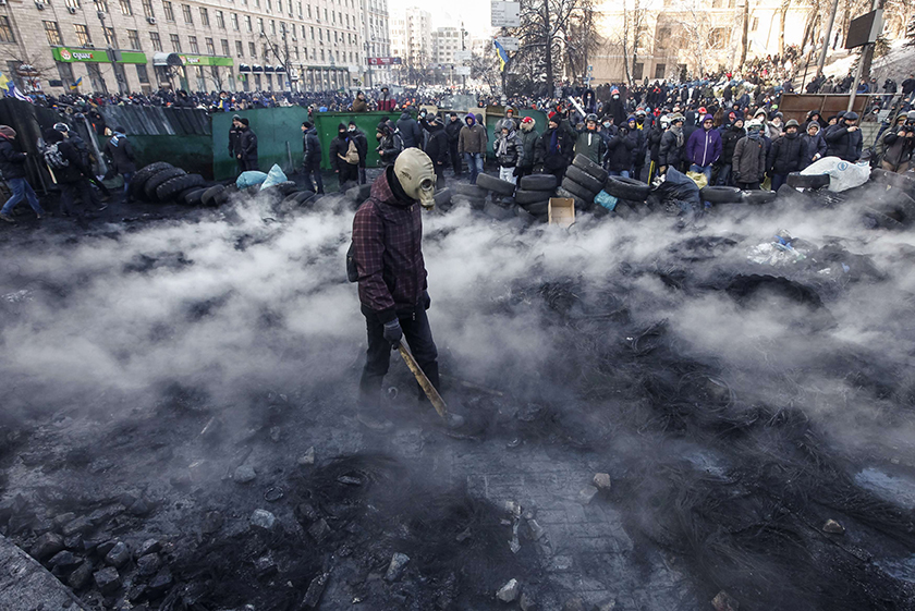 Protesters gather near clashes with riot police.