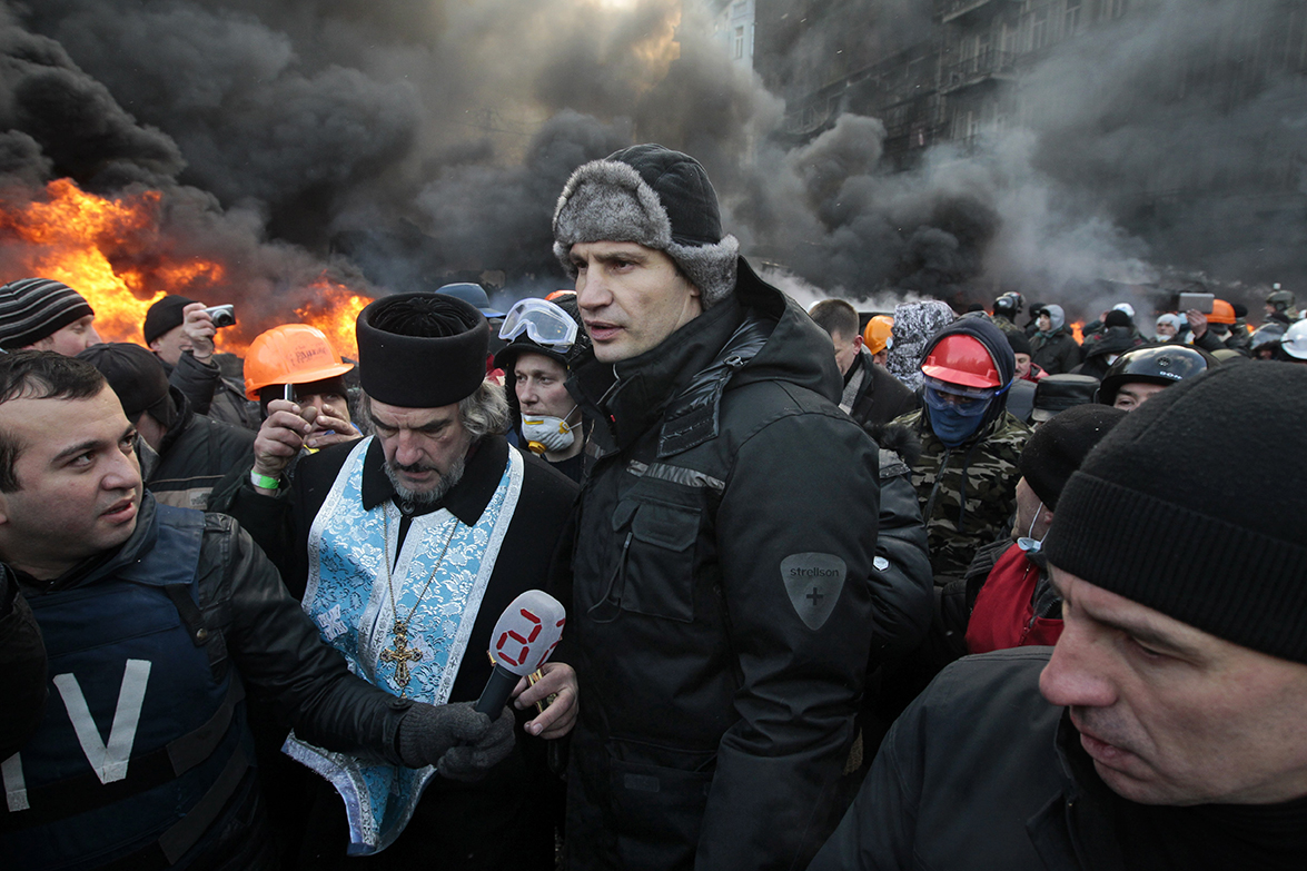Opposition leader and former boxing champion Vitali Klitschko speaks with protesters.