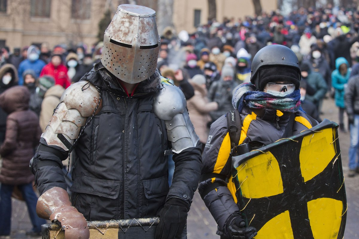 Protesters clad in improvised protective gear prepare for a clash with police in central Kiev.