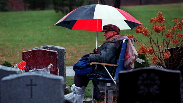 Rain, hail or shine: Rocky 'Roque' Abalsamo has sat by the grave of his wife, Julita, at St. Joseph's Cemetery in Boston since she died in 1993. On January 22 he passed away