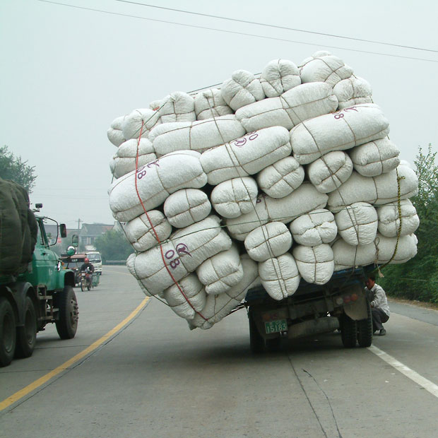 A driver stops to examine his overloaded truck on 204 national highway in Hai'an.