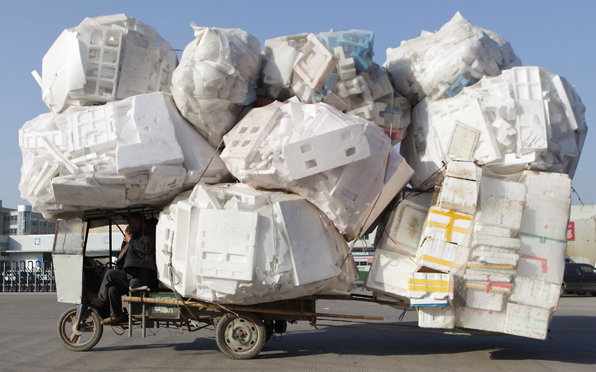 An electric tricycle is used to transport recyclable material in Zhuji.