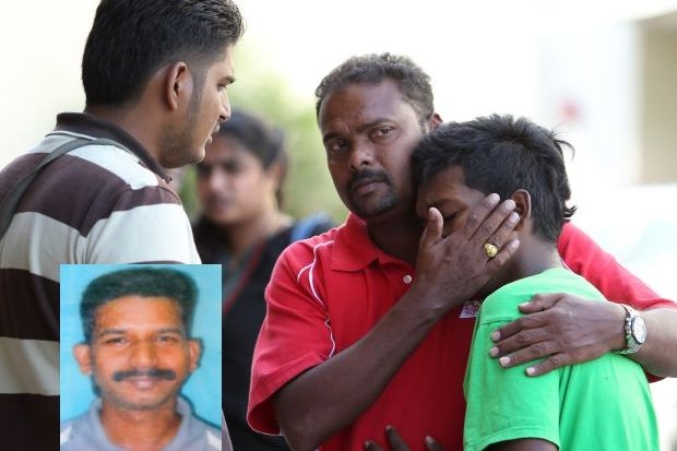 Melvyn Shanesh, who witnessed the tragic death of his father Satish (inset), being consoled by a relative at the Putrajaya Hospital